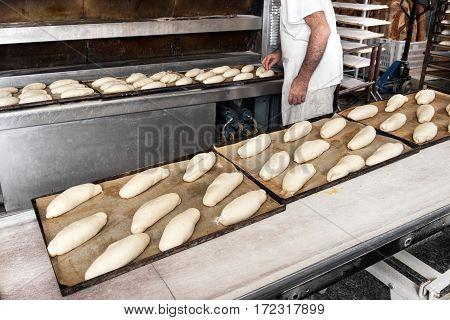 Baker Making Bread In Bakery