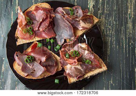 Smoked Prosciutto Ham On Bread Slices