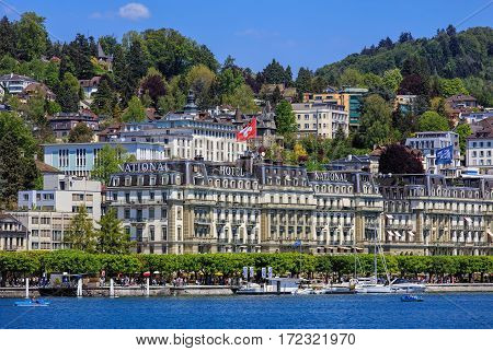 Lucerne, Switzerland - 8 May, 2016: people in boats on Lake Lucerne, buildings of the city in the background. Lucerne is a city in central Switzerland, it is the capital of the Swiss canton of Lucerne and the capital of the district of the same name.