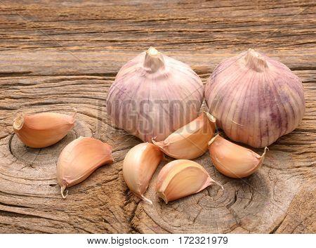 Garlic on the wooden background in studio