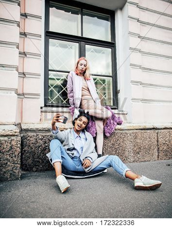 Two teenage girls infront of university building smiling, having fun traveling europe, lifestyle people concept close up