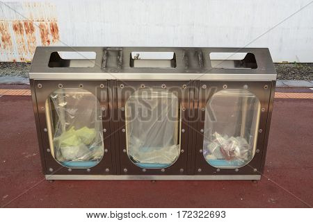 recycling and garbage bins, Waste recycling . Recycling paper, glass, plastic, metal. Different colored recycle waste bins in flat