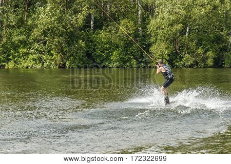 Belarus, Minsk, 07.09.2016: The man trains to balance on the board for kitesurfing