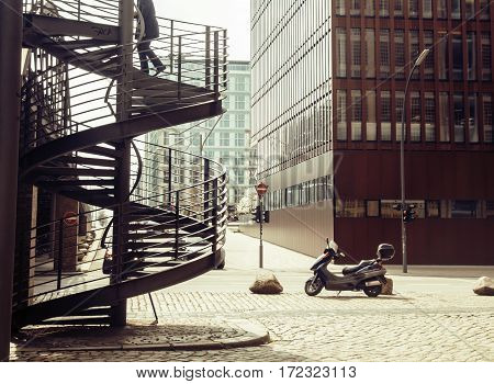 Card view: european street with stairs and motobike vintage, noone close up