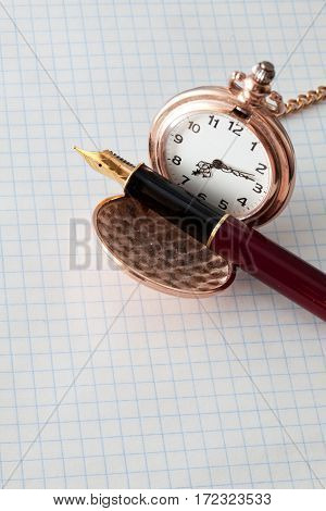 Beautiful pen and pocket watch on notebook