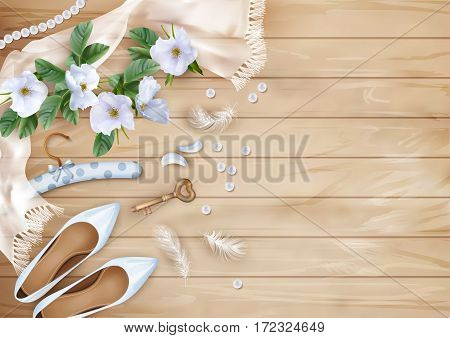 Wedding floral top view background with white flowers, shoes, feathers, silk scarf, pearl beads on a wooden floor
