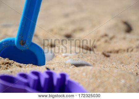 Children's set for game with sand on the seashore. Crimea. Black Sea