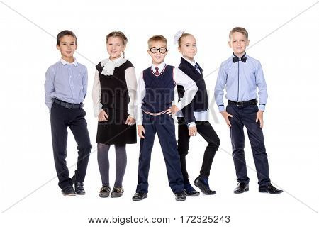 Group of smart school children posing together at studio. School uniform. Educational concept. Isolated over white.