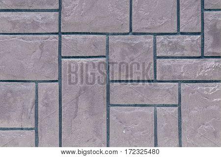 wall background of gray rectangular stones closeup