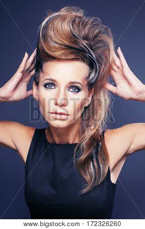 young elegant woman with creative hair style zebra print close up pretty like punk studio halloween look fashion