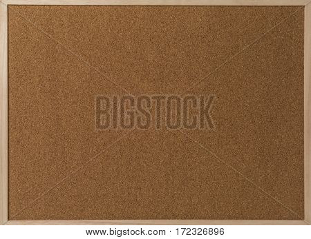 Fragment of a brown cork texture in wooden frame.