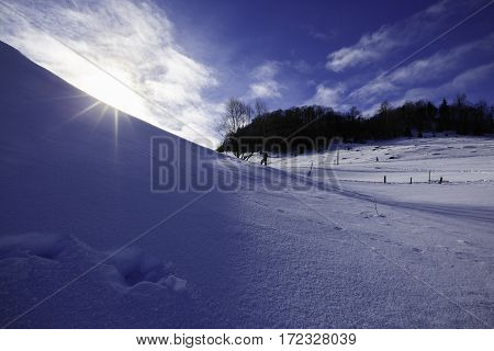professional photographer making pictures of the mountain in winter