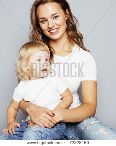 mother with daughter together on white background happy smiling, cute family close up, lifestyle people concept, cool real modern woman isolated