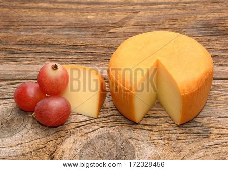 still life with cheese and red grapes