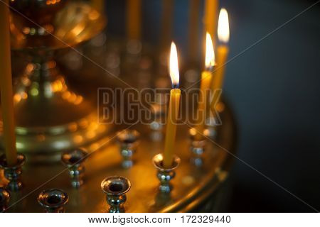 The candle flame in orthodox church selective focus close up