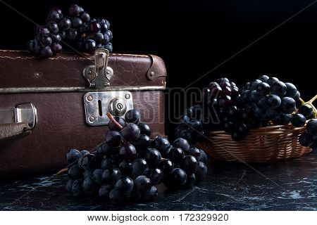 Cluster Of Blue Grapes On Dark Marble Background. Vintage Case On Back Background.