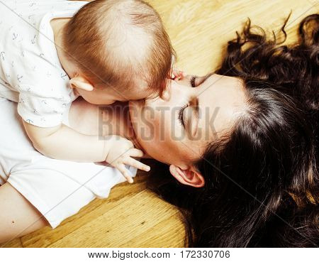 young brunette happy mother holding toddler baby son, breast-feeding concept, lifestyle modern people close up