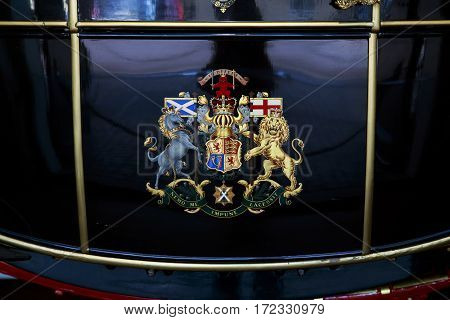 LONDON, GREAT BRITAIN - MAY 17, 2014: This is coat of arms of Great Britain on the door of one of the royal carriages in the Royal Mews.