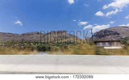 the view from the car window on the move traveling summer sunny day for Greece photo dynamics