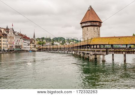 Historic city center of Lucerne with Chapel Bridge and lake Lucerne under dramatic sky, Canton of Lucerne, Switzerland