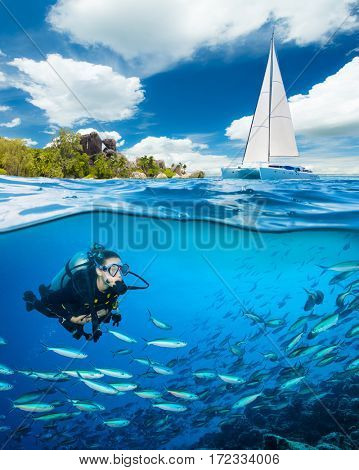 Young woman doing scuba diving and exploring coral reef. Underwater sports and tropical vacation template