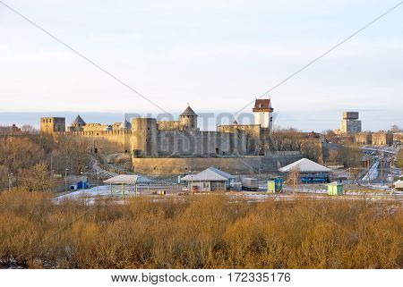 IVANGOROD, RUSSIA - JANUARY 3, 2017: View for Multilateral transport crossing point near Russian-Estonian border. On the background is Ivangorod Fortress and Hermann Castle in Narva