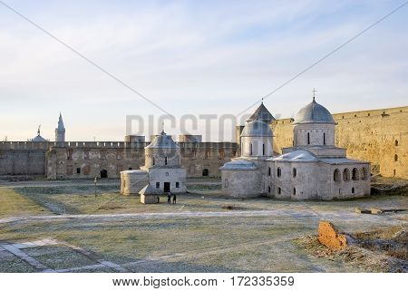 IVANGOROD, RUSSIA - JANUARY 3, 2017: Ancient Church of Saint Nicholas and Church of Dormition of the Mother of God on territory of Ivangorod Fortress that was built in 1492. Now it is a museum.