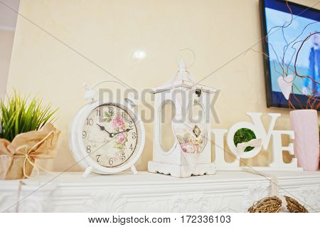 Decorative Clock, Candlestick And Love Words On Decor At Beauty Salon.