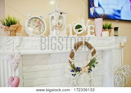 Decorative Wreath, Clock And Love Words On Decor At Beauty Salon.