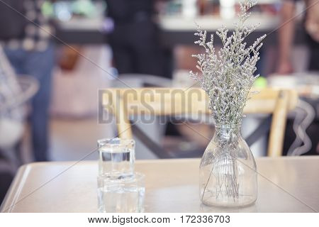 flower in Glass vase on dinning table with vintage filter