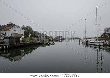 fog on the swedish westcoast the boat is in the harbour