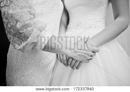 Mom Hand Hold Her Daughter Bride On Wedding Day. Black And White Photo