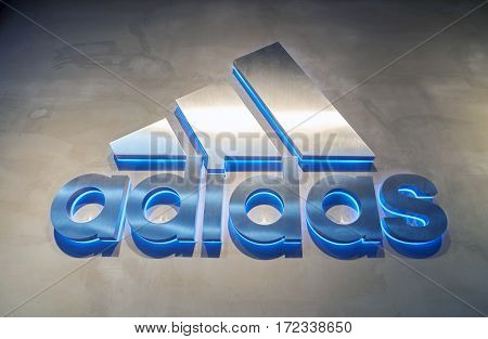 HONG KONG - CIRCA NOVEMBER, 2016: Adidas sign at a store in Hong Kong. Adidas AG is a German multinational corporation that designs and manufactures shoes, clothing and accessories.