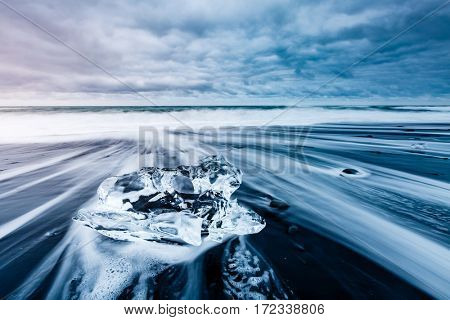 Large pieces of the iceberg that sparkle on the black sand. Picturesque and gorgeous scene. Location famous place Jokulsarlon lagoon, Vatnajokull national park, island Iceland, Europe. Beauty world.