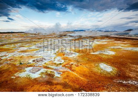 Ominous view geothermal area Hverir (Hverarond). Popular tourist attraction. Dramatic and picturesque scene. Location place Myvatn lake, Krafla, Iceland, Europe. Discover the world of beauty.