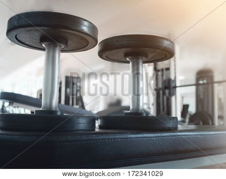 Close up Dumbbells foreground at the gym.