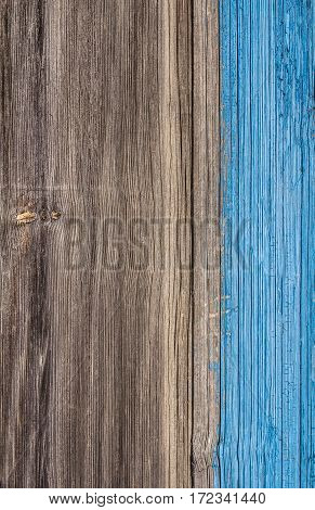 surface of an old wooden board. Half shaded blue paint.
