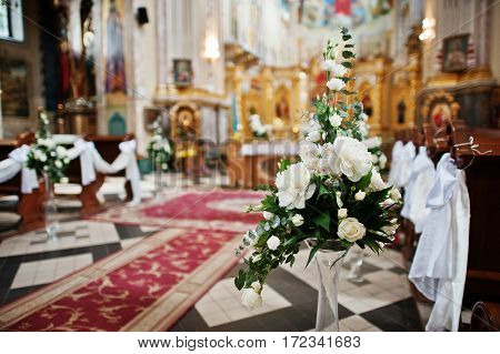 Decoration Of Flowers On Vases At Church On Wedding Ceremony.
