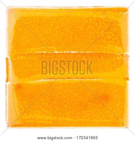 Orange lined handmade glazed ceramic tile isolated on white background