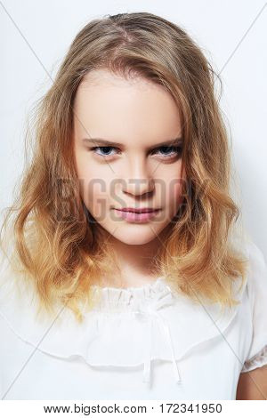 Young Teenage Girl Face Looking Rebellious studio shot
