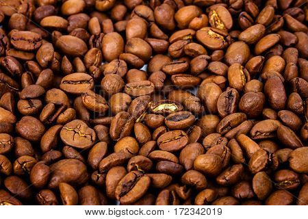 Background of roasted coffee beans selective focus in the center