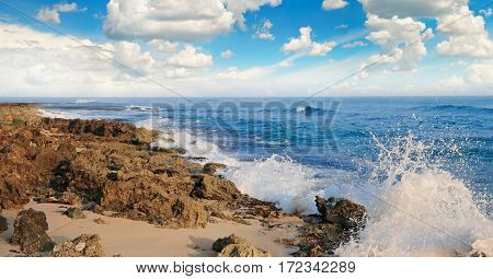 tropical ocean, picturesque beach and blue sky