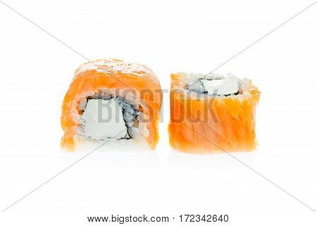 Two sushi rolls with smocked salmon isolated on white background