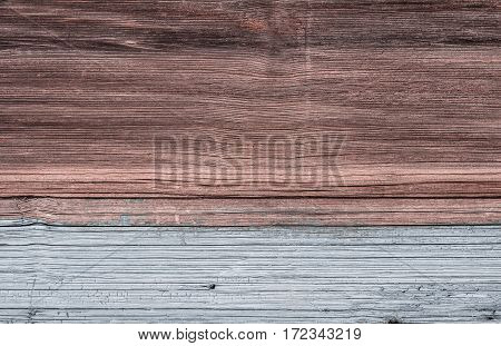 surface of an old wooden board. Half shaded white paint.