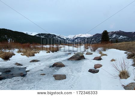 Snow and ice cover Moraine Park along the Big Thompson River in Rocky Mountain National Park