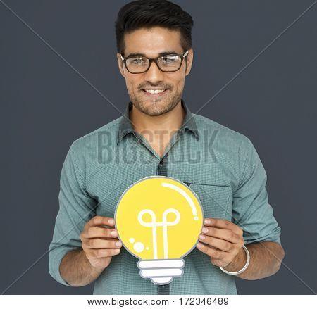 A man holding light bulb with an ideas