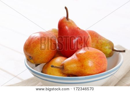 bowl of ripe red pears - close up