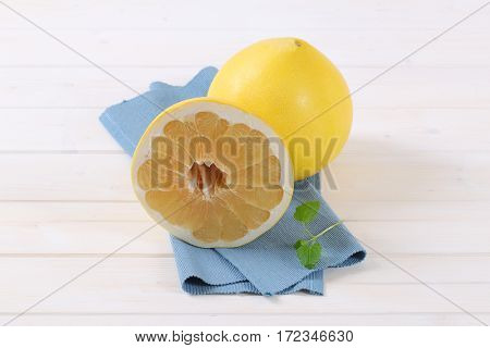 fresh ripe pomelo on blue place mat