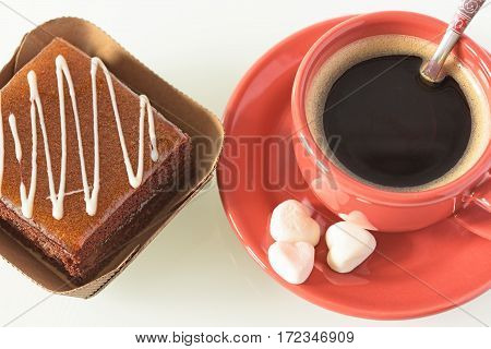 Cake and cup of coffee on the table. Cake sweet dessert.