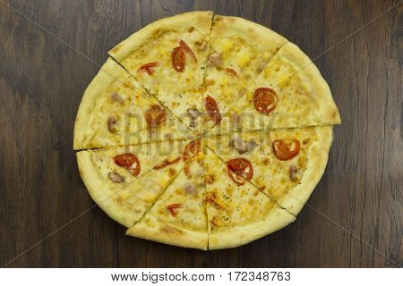 large pizza with tomatoes and cheese with ham meat chicken with green sauce delicious fast food is bad food is bad food